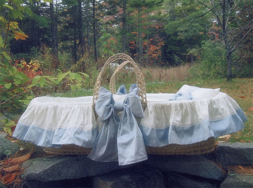 A classic blue and white moses basket fit for His Royal Highness Prince of Cambridge from www.wellappointedhouse.com