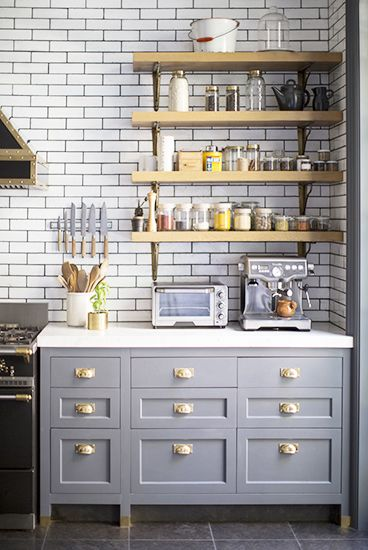 Here is another example of gray cabinets paired with brass knobs