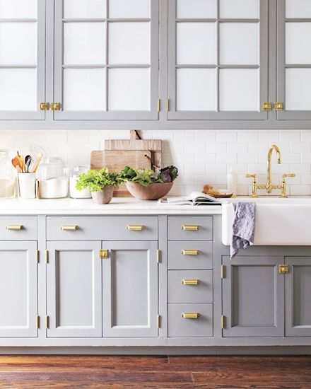 Home decor trend gray in the kitchen and bathroom the for Brass hardware for kitchen cabinets