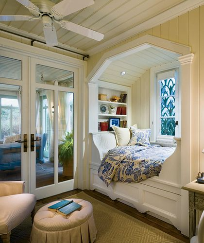 Here is another fun reading nook - this one is built right into the wall under a window.  Charming!