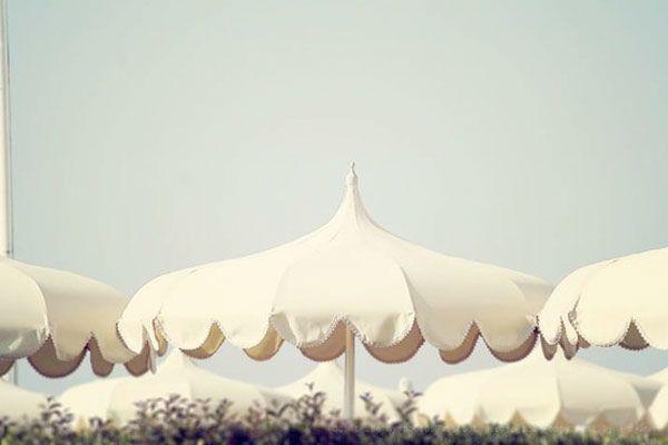 scalloped white umbrella